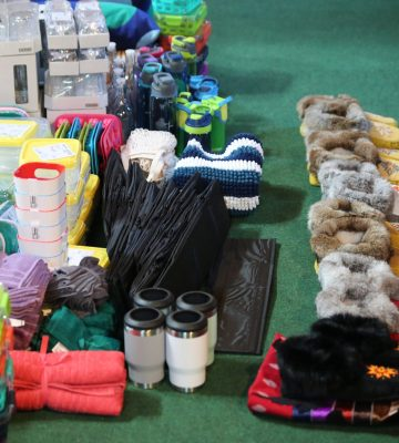 Gifts, including moccasins, for a ceremony in the roundhouse