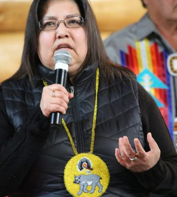 Chief Loraine Cobiness, speaking into a microphone.
