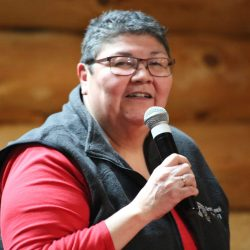 Chief Marilyn Sinclair speaking into a microphone at a ceremony.