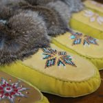 A row of beaded moccasins lined up.